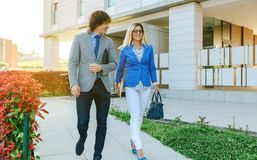 Businessman and businesswoman leaving the office Stock Images