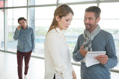 Businessman and businesswoman look working together royalty free stock photo