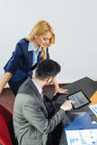 Businessman and businesswoman looking at document in di Stock Photography