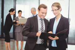 Businessman and businesswoman looking at file Royalty Free Stock Photo