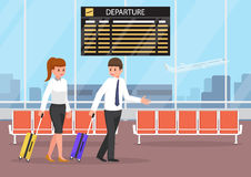 Businessman and businesswoman with luggage at the airport termin Royalty Free Stock Photography