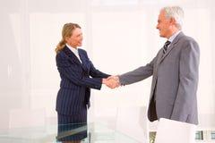 Businessman and businesswoman meet royalty free stock photos
