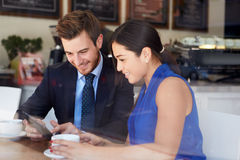 Businessman And Businesswoman Meeting In Coffee Shop stock photo