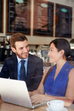 Businessman And Businesswoman Meeting In Coffee Shop Royalty Free Stock Images