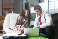 Businessman and businesswoman at meeting with laptop Royalty Free Stock Photography