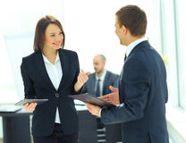 Businessman And Businesswoman Meeting. In Modern Office Royalty Free Stock Image