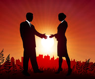Businessman and Businesswoman meeting on sunset background Stock Photo