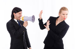 Businessman and businesswoman with megaphone Stock Images