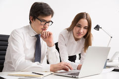 Businessman and businesswoman in office Royalty Free Stock Photo