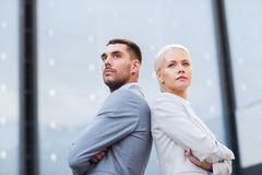 Businessman and businesswoman outdoors Royalty Free Stock Photography