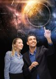 Businessman and businesswoman over space Stock Photo