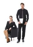 Businessman and businesswoman over white Stock Images