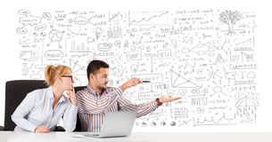 Businessman and businesswoman planning and calculating with vari Royalty Free Stock Images