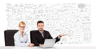 Businessman and businesswoman planning and calculating with vari Royalty Free Stock Image