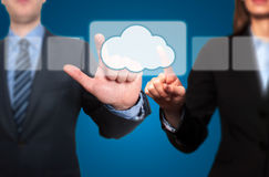 Businessman and Businesswoman pressing pressing cloud icon Stock Photo