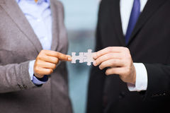 Businessman and businesswoman with puzzle pieces stock photos