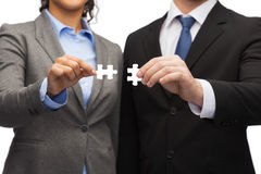 Businessman and businesswoman with puzzle pieces Royalty Free Stock Photo
