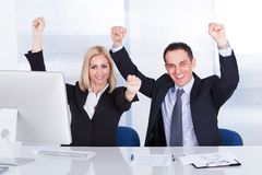 Businessman And Businesswoman Raising Hand Stock Image