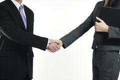 Businessman and businesswoman shaking hands Royalty Free Stock Photo