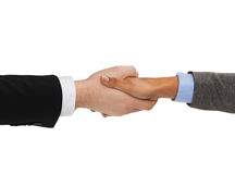 Businessman and businesswoman shaking hands Royalty Free Stock Photography