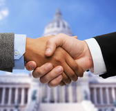 Businessman and businesswoman shaking hands Stock Image