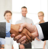 Businessman and businesswoman shaking hands Stock Photos