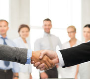 Businessman and businesswoman shaking hands Royalty Free Stock Images