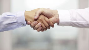 Businessman and businesswoman shaking hands stock footage