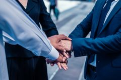 businessman and businesswoman shaking hands for demonstrating th royalty free stock photos