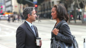 Businessman And Businesswoman Shaking Hands. Businessman and businesswoman talk in the street before shaking hands.Shot on Canon 5d Mk2 with a frame rate of stock video footage