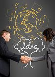 Businessman and businesswoman shaking their hands in front of a grey background with a representatio Stock Image