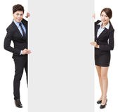 Businessman and businesswoman showing the  board Stock Images