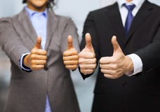 Businessman and businesswoman showing thumbs up Royalty Free Stock Photo
