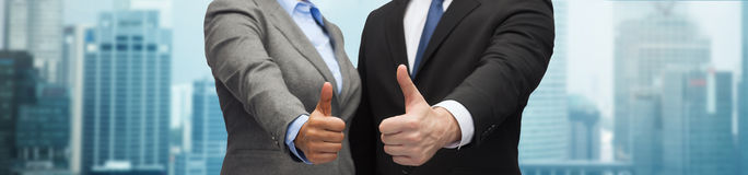 Businessman and businesswoman showing thumbs up Royalty Free Stock Images