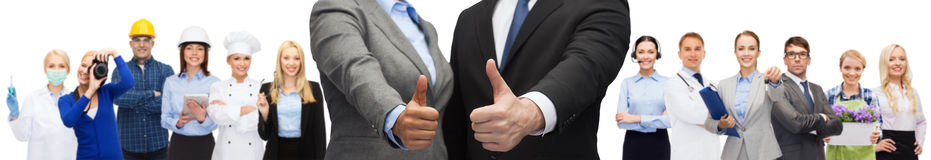 Businessman and businesswoman showing thumbs up Stock Image