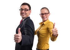 Businessman and businesswoman showing thumbs up Royalty Free Stock Photos