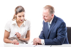 Businessman and businesswoman signing a papers Royalty Free Stock Photos