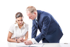 Businessman and businesswoman signing a papers Royalty Free Stock Photography