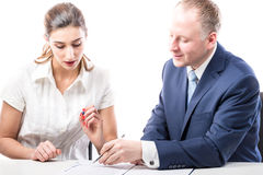Businessman and businesswoman signing a papers Royalty Free Stock Image