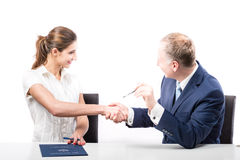 Businessman and businesswoman signing a papers Stock Photo