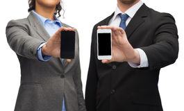 Businessman and businesswoman with smartphones Stock Photo