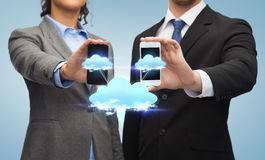 Businessman and businesswoman with smartphones Royalty Free Stock Image