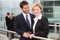 Businessman and businesswoman smiling Royalty Free Stock Image