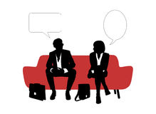 Businessman and businesswoman speaking seated on red sofa. Black and white silhouettes of young businessman and businesswoman seated on red sofa having rest and Royalty Free Stock Photos