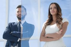 Businessman and businesswoman standing together stock photo