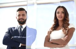 Businessman and businesswoman standing together stock images