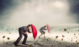 Businessman and businesswoman in storm Stock Image