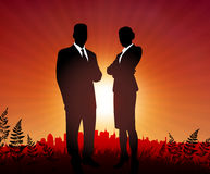 Businessman and Businesswoman on sunset background Stock Photo