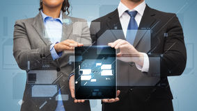 Businessman and businesswoman with tablet pc Royalty Free Stock Image