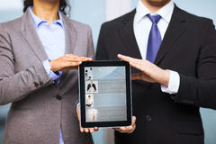 Businessman and businesswoman with tablet pc Royalty Free Stock Photography